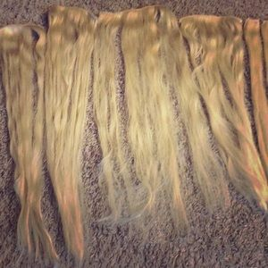 Bleach blonde Bellami clip in hair extensions